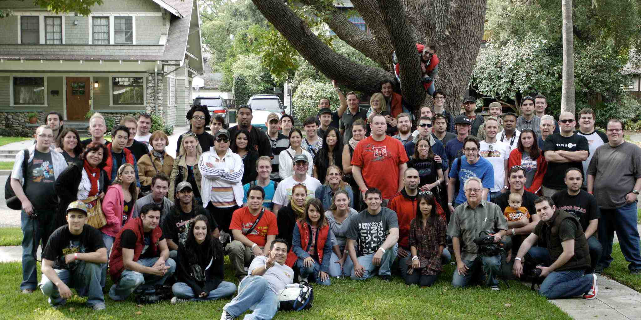 Group photo of visitors at the Peeping Tom tree with the film's director, John McDonald